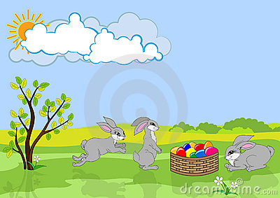 Three Easter rabbits and basket with color eggs.