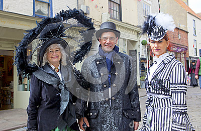 Three elegant participants on Whitby Gothic Weekend. Editorial Stock Photo