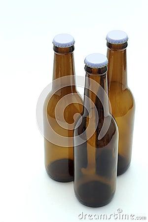 Three empty bottles of beer