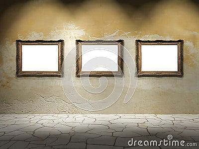 Three empty frames on aged wall