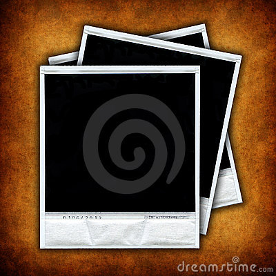 Three empty photo frames over grunge background