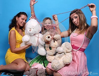 Three female friends with teddy bears and beads
