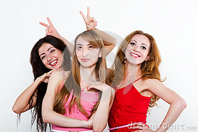 Three female friends on white background