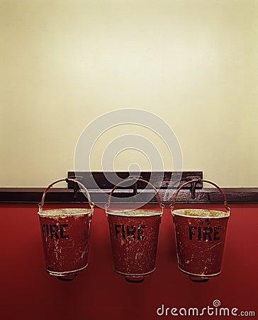 Three fire buckets