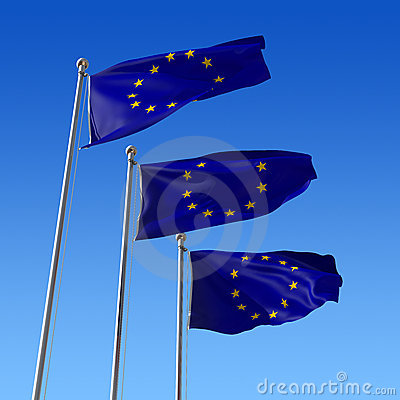 Three flags of Europe Union against blue sky.