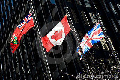 Three flags: Ontarian, Canadian, British