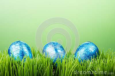 Three foil Easter eggs on grass