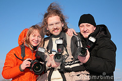 Three fotographers against blue sky 2
