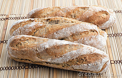 Three fresh bread baguettes