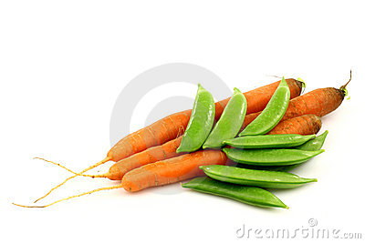 Three fresh carrots and some sugar snaps