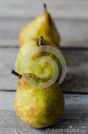 Free Three Fresh Ripe Pears In Row Stock Photography - 48596072
