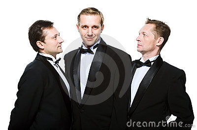 Three friends in a black tuxedo