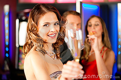Three friends with champagner in a bar