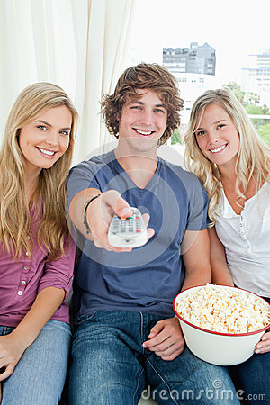 Three friends eating popcorn together
