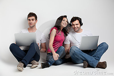 Three friends holding laptops expressions