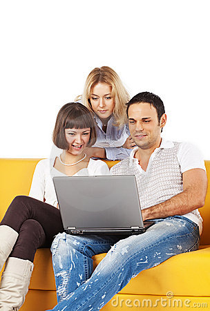 Three friends with laptop computer