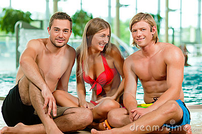 Three friends in public swimming pool