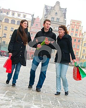 Three friends on a street