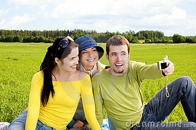 Three friends taking a photo of themselves