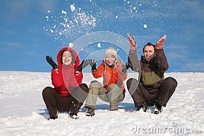 Three friends throw snows