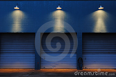 Three Garage Doors at Night w Outdoor Lighting