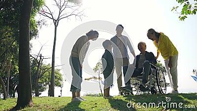 Three generation asian family enjoying outdoor activity in park. Happy three generation asian family having fun enjoying nature outdoor activity in park stock video