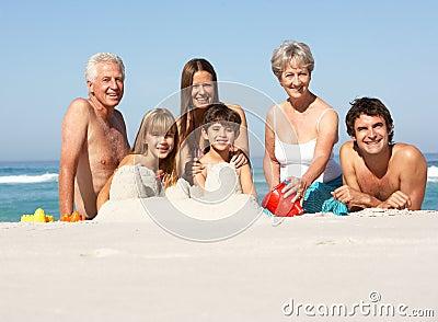 Three Generation Family Building Sandcastles