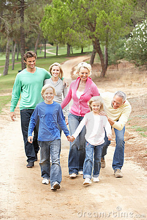 Three Generation Family enjoying walk in park