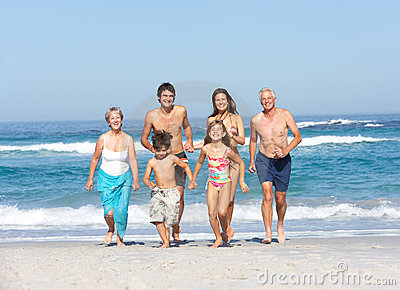 Three Generation Family On Holiday On Beach