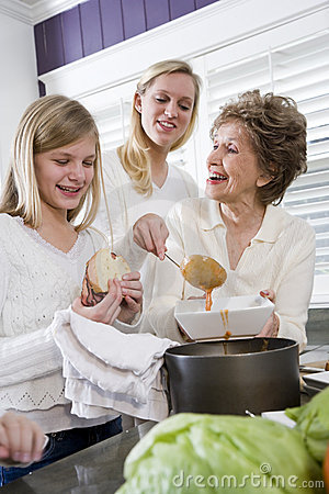 Three generation family at home serving lunch