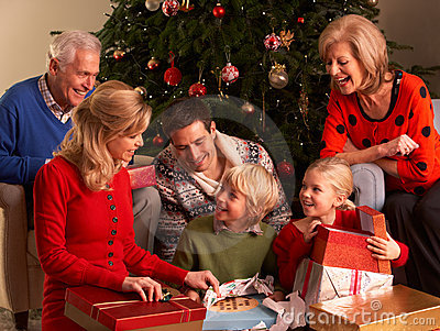 Three Generation Family Opening Christmas Gifts