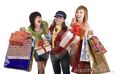 Three girlfriends enjoy shopping. Isolated.