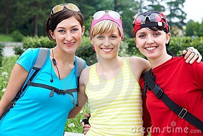 Three girlfriends in sports clothes