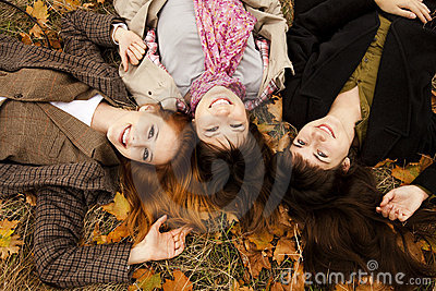 Three girls in the autumn park.