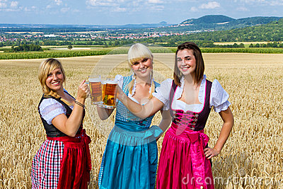 Three girls with beer mugs