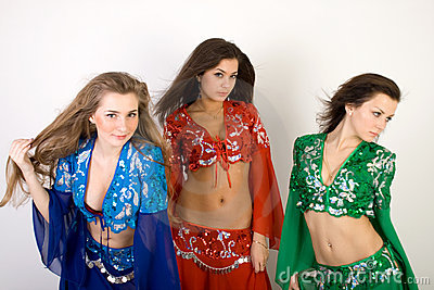 Three girls belly dancing