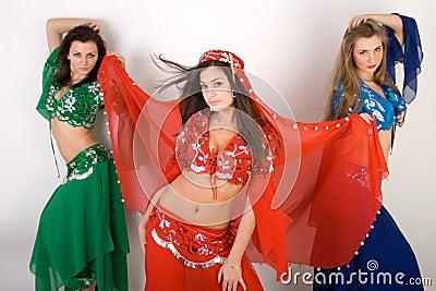 Three girls belly dancing
