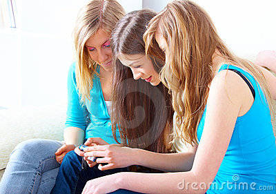 Three girls with digital camera