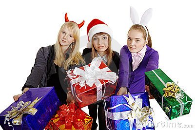 Three girls hand over New Year s gifts