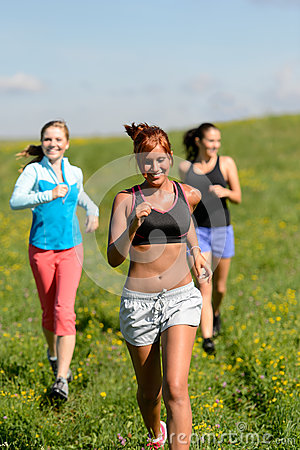 Free Three Girls Jogging Downhill Summer Meadow Stock Photo - 38688250