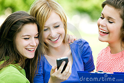 Three girls looking at mobile phone