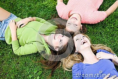 Three girls lying on the grass