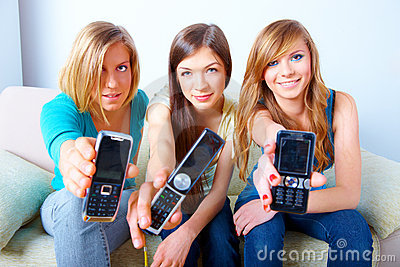 Three girls with mobile phones