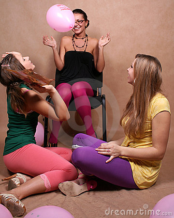 Three girls playing with balloons