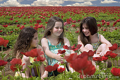 Three girls in a red field