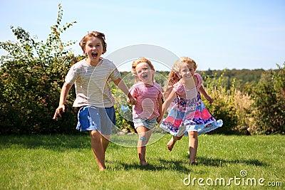 Three girls running outdoor laughing