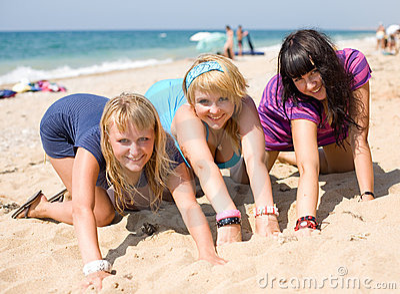 Three girls on seashore