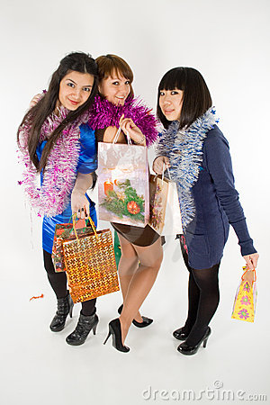 Three girls with shopping bags