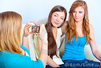 Three girls taking photos