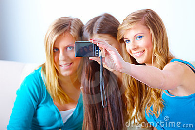 Three girls taking photos